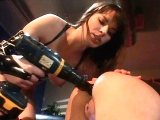 Steamy Brunettte Dana Gets Her Asshole Pounded With A Fake Penis Affixed To Drill